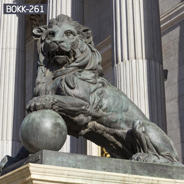Outdoor big brass lion with paw on ball for garden BOKK-261